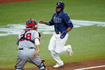 Tampa Bay Rays' Manuel Margot scores around Washington Nationals catcher Kurt Suzuki (28) on a two-run single by Kevin Kiermaier during the fifth inning of a baseball game Tuesday, Sept. 15, 2020, in St. Petersburg, Fla. (AP Photo/Chris O'Meara)