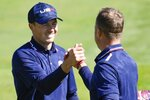 Team USA's Jordan Spieth and Team USA's Justin Thomas celebrate after winning their foursomes match the Ryder Cup at the Whistling Straits Golf Course Saturday, Sept. 25, 2021, in Sheboygan, Wis. (AP Photo/Ashley Landis)