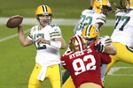 Green Bay Packers quarterback Aaron Rodgers (12) passes against the San Francisco 49ers during the first half of an NFL football game in Santa Clara, Calif., Thursday, Nov. 5, 2020. (AP Photo/Jed Jacobsohn)