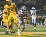 Kansas State running back Deuce Vaughn (22) score a touchdown past Baylor safety JT Woods (22) during the first half of an NCAA college football game Saturday, Nov. 28, 2020, in Waco, Texas. (Jerry Larson/Waco Tribune Herald via AP)