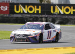 Denny Hamlin drives through Turn 3 during a NASCAR Cup Series auto race at Daytona International Speedway, Sunday, Aug. 16, 2020, in Daytona Beach, Fla. (AP Photo/Terry Renna)