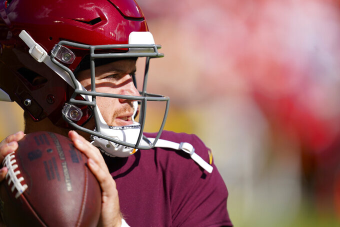 Washington Football Team quarterback Taylor Heinicke (4) throwing the ball during pregame warmups prior to the start of the first half of an NFL football game against the Kansas City Chiefs, Sunday, Oct. 17, 2021, in Landover, Md. (AP Photo/Patrick Semansky)