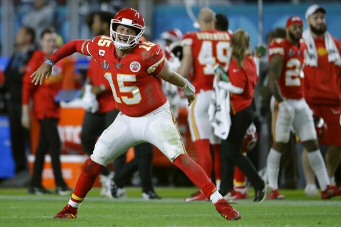 FILE - In this Feb. 2, 2020, file photo, Kansas City Chiefs' quarterback Patrick Mahomes celebrates his touchdown pass to Damien Williams in the the second half of the NFL Super Bowl 54 football game in Miami Gardens, Fla. (AP Photo/John Bazemore, File)