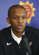 Phoenix Suns general manager James Jones talks about the re-signing of Kelly Oubre Jr. with the Suns NBA basketball team during a news conference Tuesday, July 16, 2019, in Phoenix. (AP Photo/Ross D. Franklin)