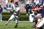 Texas A&M running back Devon Achane (6) carries the ball during the first half of an NCAA college football game against Auburn on Saturday, Dec. 5, 2020, in Auburn, Ala. (AP Photo/Butch Dill)