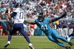 Jacksonville Jaguars outside linebacker Josh Allen (41) pressures Tennessee Titans quarterback Ryan Tannehill (17) during the first half of an NFL football game, Sunday, Oct. 10, 2021, in Jacksonville, Fla. (AP Photo/Stephen B. Morton)
