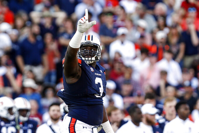 Auburn defensive end Marlon Davidson (3) reacts after a stop against Alabama during the first half of an NCAA college football game Saturday, Nov. 30, 2019, in Auburn, Ala. (AP Photo/Butch Dill)