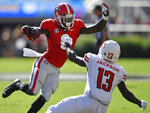 Georgia wide receiver Riley Ridley (8) runs by Austin Peay defensive back Kordell Jackson (13) during the first half of an NCAA college football game, Saturday, Sept. 1, 2018, in Athens, Ga. (AP Photo/Mike Stewart)