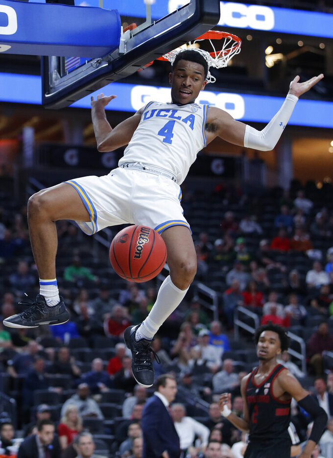 UCLA's Jaylen Hands dunks against Stanford during the first half of an NCAA college basketball game in the first round of the Pac-12 men's tournament, Wednesday, March 13, 2019, in Las Vegas. (AP Photo/John Locher)