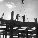 In this undated photo provided by the National Museum of Industrial History, construction workers help guide a girder into place during the construction of Martin Tower in Bethlehem, Pa. The 21-story building, the former global headquarters of defunct steelmaker Bethlehem Steel Corp., is set to be imploded on May 19, 2019. (National Museum of Industrial History via AP)
