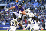 Baltimore Ravens tight end Mark Andrews (89) leaps over Los Angeles Chargers defenders as he rushes the ball in the second half of an NFL wild card playoff football game, Sunday, Jan. 6, 2019, in Baltimore. (AP Photo/Nick Wass)