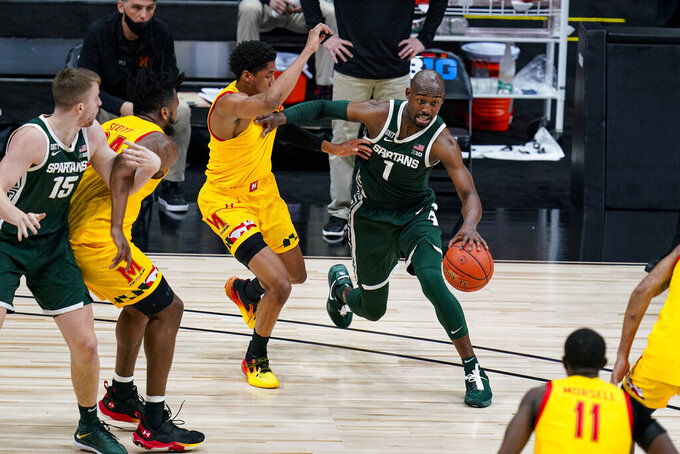 Michigan State guard Joshua Langford (1) drives around Maryland guard Aaron Wiggins (2) in the first half of an NCAA college basketball game at the Big Ten Conference tournament in Indianapolis, Thursday, March 11, 2021. (AP Photo/Michael Conroy)