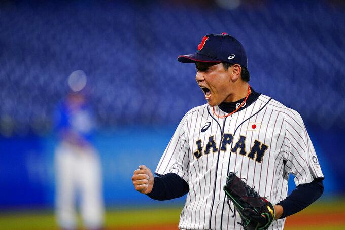 Japan's Ryoji Kuribayashicelebrate after a semi-final baseball game against South Korea at the 2020 Summer Olympics, Wednesday, Aug. 4, 2021, in Yokohama, Japan. Japan won 5-2. (AP Photo/Matt Slocum)