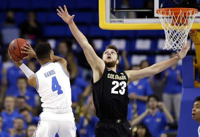 Colorado forward Lucas Siewert (23) defends UCLA guard Jaylen Hands (4) during the first half of an NCAA college basketball game Wednesday, Feb. 6, 2019, in Los Angeles. (AP Photo/Marcio Jose Sanchez)