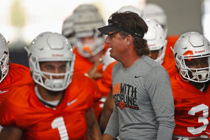Oklahoma State head coach Mike Gundy during an NCAA college football practice in Stillwater Okla., Tuesday, Aug. 6, 2019. (AP Photo/Sue Ogrocki)