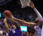 Kansas forward Dedric Lawson (1) blocks a shot by Kansas State guard Barry Brown Jr. (5) during the second half of an NCAA college basketball game in Lawrence, Kan., Monday, Feb. 25, 2019. Kansas defeated Kansas State 64-49. (AP Photo/Orlin Wagner)