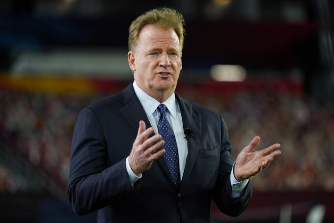 FILE - Commissioner Roger Goodell gestures during the NFL Honors ceremony as part of Super Bowl 55 in Tampa, Fla., in this Friday, Feb. 5, 2021, file photo. The NFL is increasing the regular season to 17 games, as expected, and reducing the preseason to three games. Team owners on Tuesday, March 30, 2021, approved the 17th game, marking the first time in 43 years the regular season has been increased.(AP Photo/Charlie Riedel, File)