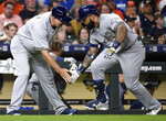 Milwaukee Brewers' Eric Thames, right, celebrates his game-tying solo home run off Houston Astros starting pitcher Justin Verlander with third base coach Ed Sedar during the seventh inning of a baseball game Wednesday, June 12, 2019, in Houston. (AP Photo/Eric Christian Smith)