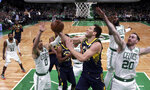 Indiana Pacers forward Bojan Bogdanovic drives to the basket past Boston Celtics forward Gordon Hayward (20) during the fourth quarter of Game 2 of an NBA basketball first-round playoff series, Wednesday, April 17, 2019, in Boston. The Celtics won 99-91. (AP Photo/Charles Krupa)