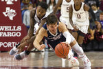 Gonzaga forward Corey Kispert (24) dives for a loose ball next to Texas A&M guard Wendell Mitchell, left, during the second half of an NCAA college basketball game Friday, Nov. 15, 2019, in College Station, Texas. (AP Photo/Sam Craft)