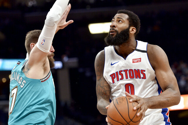Detroit Pistons center Andre Drummond (0) handles the ball against Memphis Grizzlies center Jonas Valanciunas (17) in the first half of an NBA basketball game Monday, Feb. 3, 2020, in Memphis, Tenn. (AP Photo/Brandon Dill)