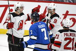 New Jersey Devils' Nico Hischier (13) celebrates his goal against the Winnipeg Jets with teammate Taylor Hall (9) during the first period of an NHL hockey game, Tuesday, Nov. 5, 2019 in Winnipeg, Manitoba. (Fred Greenslade/Canadian Press via AP
