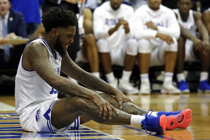 Seton Hall guard Myles Powell (13) reacts after falling to the court during the second half of an NCAA college basketball game against Michigan State on Thursday, Nov. 14, 2019, in Newark, N.J. (AP Photo/Adam Hunger)