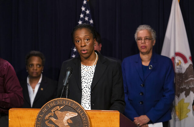 Dr. Ngozi Ezike, director of the state Department of Public Health, along with elected and health officials give their daily update on the coronavirus situation in Illinois, Thursday, March 12, 2020. (Tyler LaRiviere/Chicago Sun-Times via AP)