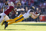 California tight end Gavin Reinwald, right, catches a pass against Stanford cornerback Kyu Blu Kelly, left, during the first half of an NCAA college football game Saturday, Nov. 23, 2019 in Stanford, Calif. (AP Photo/Tony Avelar)