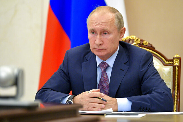 Russian President Vladimir Putin chairs a Security Council meeting via video conference in Moscow, Russia, Wednesday, Oct. 14, 2020. (Alexei Druzhinin, Sputnik, Kremlin Pool Photo via AP)