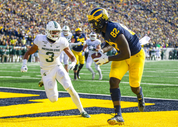 Michigan tight end Nick Eubanks (82) makes a touchdown catch ahead of Michigan State safety Xavier Henderson (3) in the second quarter of an NCAA college football game in Ann Arbor, Mich., Saturday, Nov. 16, 2019. (AP Photo/Tony Ding)