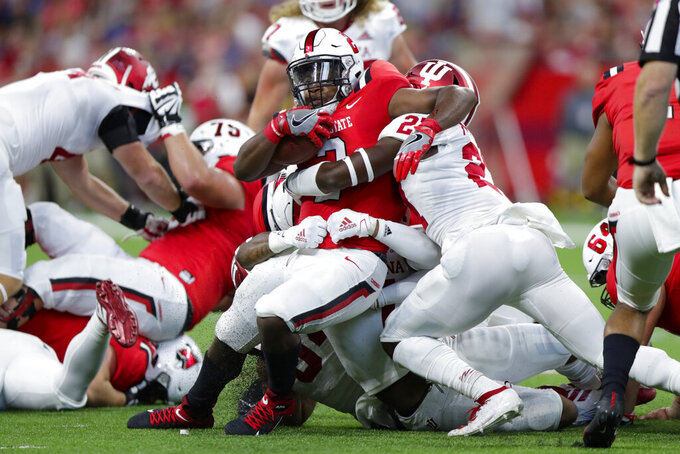 Ball State running back Caleb Huntley (2) is tackled by Indiana defensive back Devon Matthews (27) during the first half of a college football game in Indianapolis, Saturday, Aug. 31, 2019. (AP Photo/Michael Conroy)