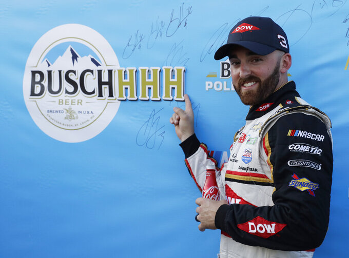 Austin Dillon points to a sign after winning the pole for the NASCAR Cup Series auto race at Chicagoland Speedway in Joliet, Ill., Saturday, June 29, 2018. (AP Photo/Nam Y. Huh)