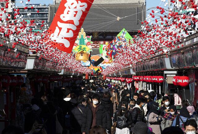 People visit Sensoji temple on New Year's Eve in Tokyo Thursday, Dec. 31, 2020. (AP Photo/Hiro Komae)