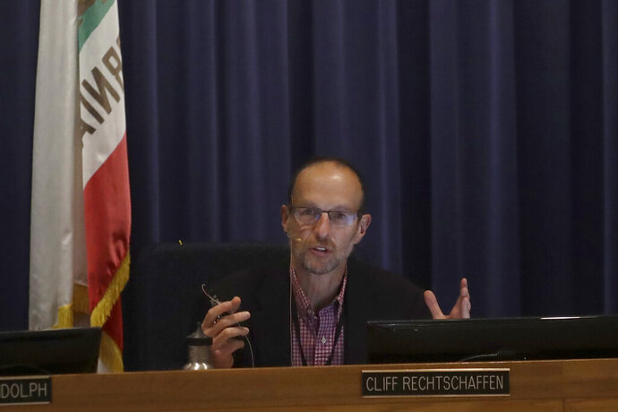 California Public Utilities Commissioner Cliff Rechtschaffen speaks at a CPUC meeting in San Francisco, Wednesday, Nov. 13, 2019. California regulators will vote Wednesday on whether to open an investigation into pre-emptive power outages that blacked out large parts of the state for much of October as strong winds sparked fears of wildfires. (AP Photo/Jeff Chiu)