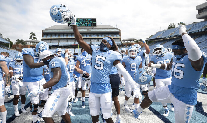 North Carolina's Dazz Newsome (5) and his teammates celebrate their victory over Syracuse on Saturday, Sept. 12, 2020, in Chapel Hill, N.C. (Robert Willett/The News & Observer via AP, Pool)