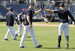 New York Yankees' Aaron Judge, left, and Giancarlo Stanton bump their gloves together after a throwing drill at baseball spring training camp, Monday, Feb. 19, 2018, in Tampa, Fla. (AP Photo/Lynne Sladky)