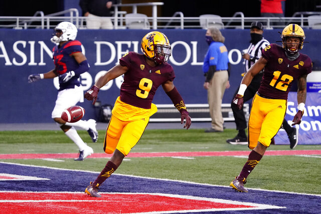 Arizona State's D.J. Taylor (9) scores a touchdown against Arizona on a kick return during the first half of an NCAA college football game Friday, Dec. 11, 2020, in Tucson, Ariz. (AP Photo/Rick Scuteri)