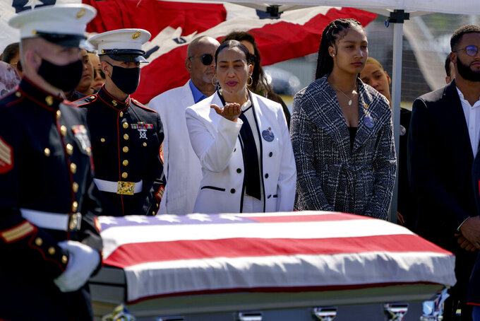 Colasa Pichardo, center, blows a kiss toward the casket of her daughter, Sgt. Johanny Rosario Pichardo, a U.S. Marine who was among 13 service members killed in a suicide bombing in Afghanistan, during a public wake in her hometown of Lawrence, Mass., Tuesday, Sept. 14, 2021. (AP Photo/David Goldman)