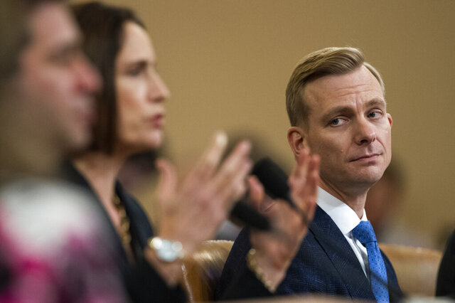 David Holmes, a U.S. diplomat in Ukraine, right, watches former White House national security aide Fiona Hill, testify before the House Intelligence Committee on Capitol Hill in Washington, Thursday, Nov. 21, 2019, during a public impeachment hearing of President Donald Trump's efforts to tie U.S. aid for Ukraine to investigations of his political opponents. (AP Photo/Manuel Balce Ceneta)
