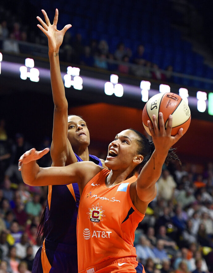 Connecticut Sun forward Alyssa Thomas shoots as Phoenix Mercury forward Dewanna Bonner defends during the first half of WNBA basketball game Friday, July 12, 2019, in Uncasville, Conn. (Sean D. Elliot/The Day via AP)