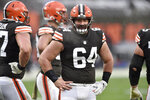 FILE - In this Sunday, Nov. 22, 2020 file photo, Cleveland Browns center JC Tretter stands on the field during an NFL football game against the Philadelphia Eagles in Cleveland. NFL players were locked out of team headquarters last offseason because of the coronavirus pandemic. This year, their union wants them to boycott any in-person OTAs. Last year, teams were forced to do everything online until training camps opened in August, and NFL Players Association president J.C. Tretter has been advocating for a repeat of last year's offseason, arguing that the adjustments caused by the coronavirus showed the arduous offseason programs were unnecessary.(AP Photo/David Richard, File)