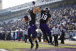 Northwestern's Tyler Haskin, left, celebrates his touchdown against Massachusetts with teammate Riley Lees during the first half of an NCAA college football game Saturday, Nov. 16, 2019, in Evanston, Ill. (AP Photo/Jim Young)