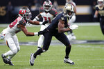 Tampa Bay Buccaneers cornerback Vernon III Hargreaves (28) tries to shirt-tackle New Orleans Saints wide receiver Michael Thomas (13) in the first half of an NFL football game in New Orleans, Sunday, Oct. 6, 2019. (AP Photo/Bill Feig)