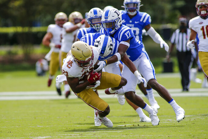 Boston College running back Travis Levy (23) is tackled by Duke defenders Jaylen Stinson (16) and Da'Quan Johnson (17)  during the first half of an NCAA college football game, Saturday, Sept. 19, 2020, in Durham, N.C. (Nell Redmond/Pool Photo via AP)