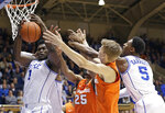 Duke's Zion Williamson (1) and RJ Barrett (5) go for a rebound against Syracuse's Tyus Battle (25) and Marek Dolezaj during the first half of an NCAA college basketball game in Durham, N.C., Monday, Jan. 14, 2019. (AP Photo/Gerry Broome)