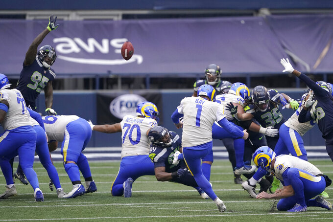 Los Angeles Rams kicker Matt Gay (1) boots a field goal against the Seattle Seahawks during the first half of an NFL wild-card playoff football game, Saturday, Jan. 9, 2021, in Seattle. (AP Photo/Ted S. Warren)