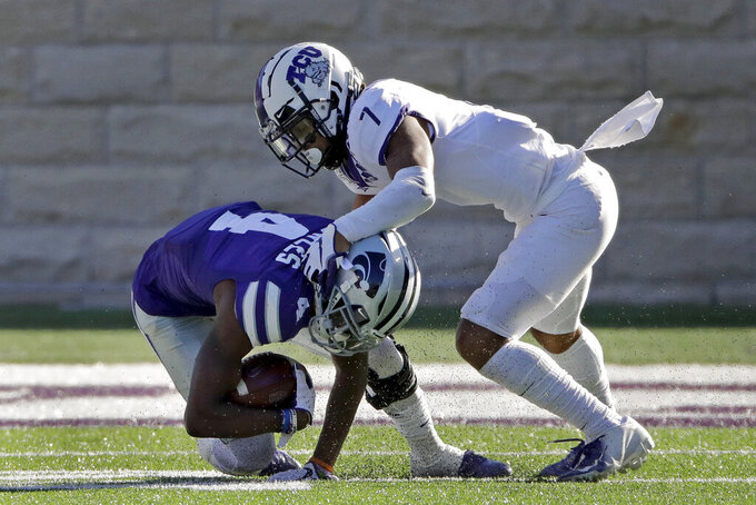 Kansas State wide receiver Malik Knowles (4) is tackled by TCU safety Trevon Moehrig (7) during the second half of an NCAA college football game Saturday, Oct. 19, 2019, in Manhattan, Kan. Kansas State won 24-17. (AP Photo/Charlie Riedel)