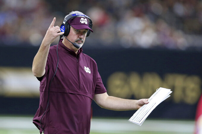 FILE - In this Aug. 31, 2019, file photo, Mississippi State head coach Joe Moorhead gestures during the second half of their NCAA college football game against the Louisiana-Lafayette, in New Orleans. Two people with knowledge of the situation say Mississippi State has fired coach Joe Moorhead after just two seasons. They spoke to The Associated Press on condition of anonymity because an announcement had not yet been made by the school. A meeting was scheduled Friday, Jan. 3, 2020, with Moorhead and athletic director John Cohen.(AP Photo/Chuck Cook, File)