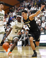 Colorado State guard Kendle Moore, front left, drives past Colorado guard Maddox Daniels in the first half of an NCAA college basketball game at in Fort Collins, Colo., Friday, Dec. 13, 2019. (Bethany Baker/Fort Collins Coloradoan via AP)